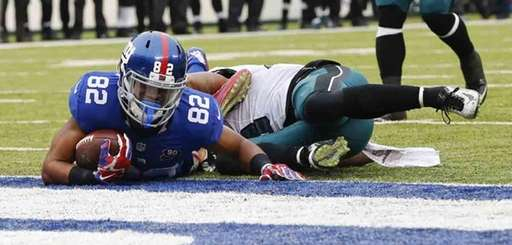 Philadelphia Eagles' Nolan Carroll tackles Rueben Randle near