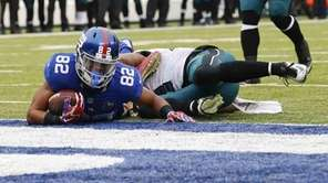 Philadelphia Eagles' Nolan Carroll tackles Rueben Randle near