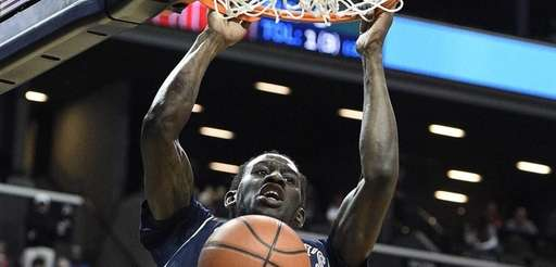 St. John's Red Storm guard Sir'Dominic Pointer dunks