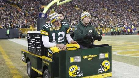 The Green Bay Packers' Aaron Rodgers is taken