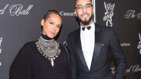 Alicia Keys and Swizz Beatz attend the 2014