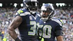 The Seattle Seahawks' Kam Chancellor, left, and K.J.