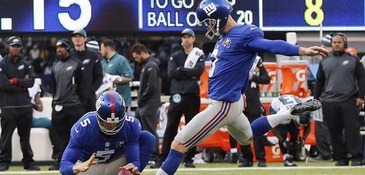 The New York Giants' Josh Brown (3) kicks