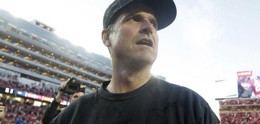 San Francisco 49ers head coach Jim Harbaugh walks