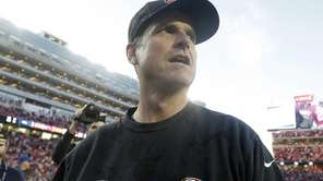 San Francisco 49ers head coach Jim Harbaugh walks