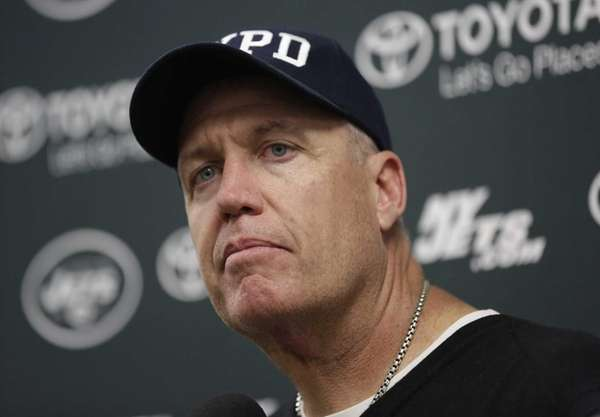 Jets head coach Rex Ryan listens to questions
