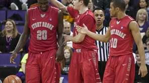 From left, Stony Brook's Jameel Warney, Kameron Mitchell,