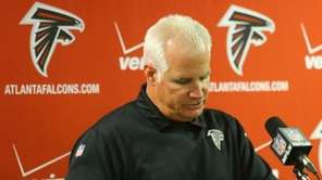 Atlanta Falcons head coach Mike Smith speaks at