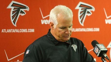 Atlanta Falcons head coach Mike Smith speaks at