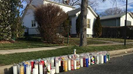 Votive candles line the curb in front of
