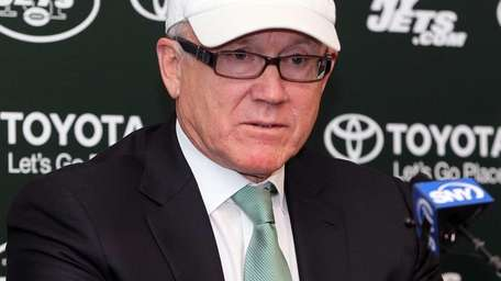 Jets owner Woody Johnson talks to the media