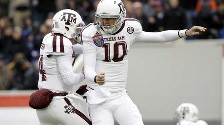 Texas A&M quarterback Kyle Allen (10) celebrates with