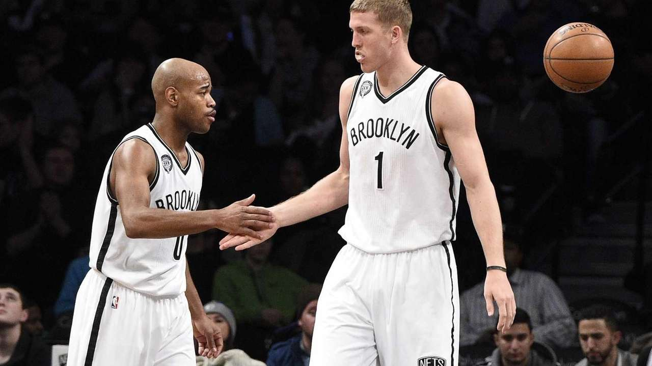 Brooklyn Nets center Mason Plumlee, right, and guard