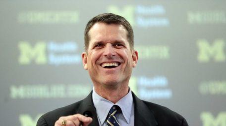 Jim Harbaugh, Michigan's head football coach, addresses the