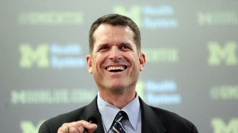 Jim Harbaugh, Michigan's head football coach, addresses the