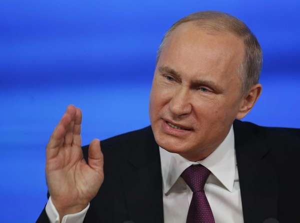 Russian President Vladimir Putin gestures during his annual