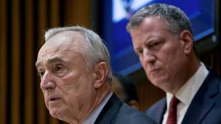 NYPD Commissioner William Bratton answers questions along with