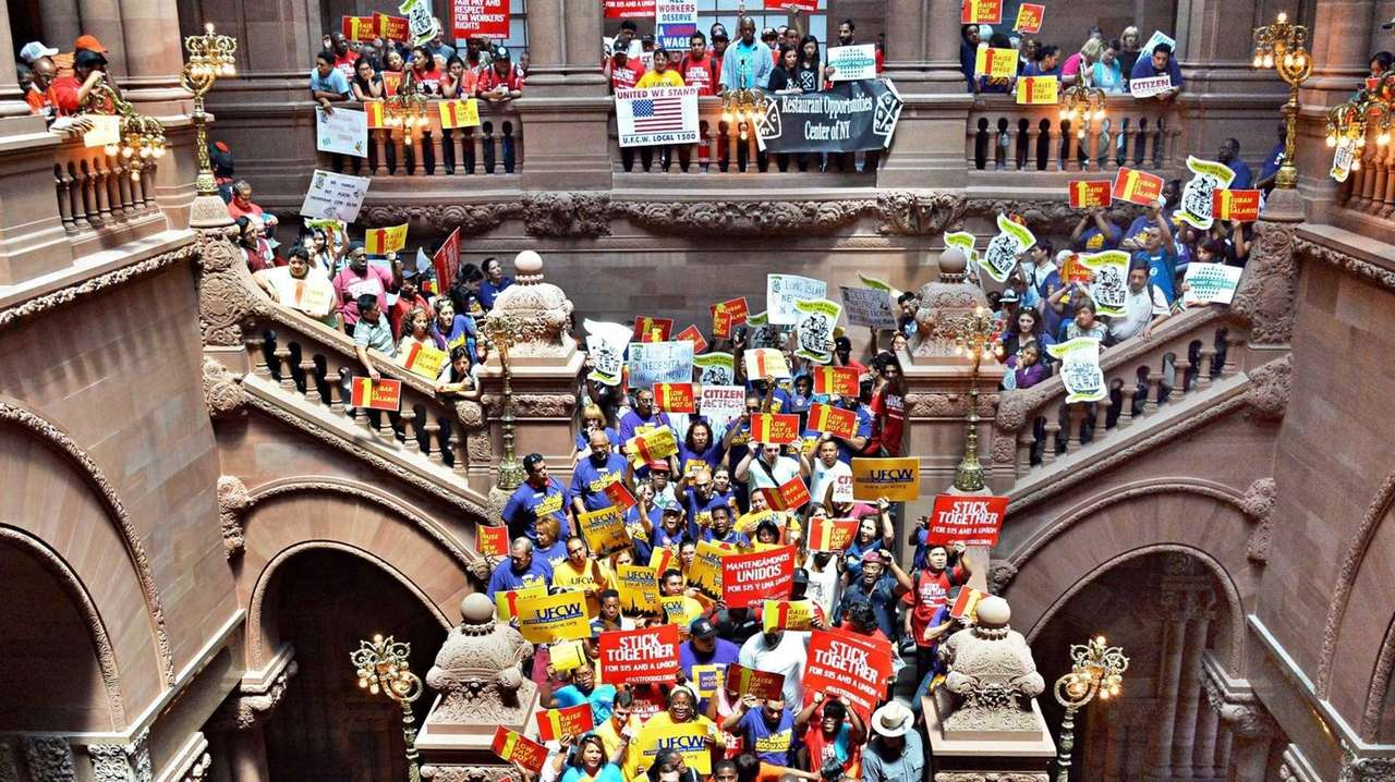 Demonstrators for minimum wage increases for fast-food workers