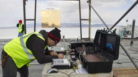 Pyrotechnician Anthony Mortati works on a data line