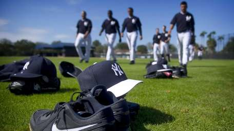 Equipment sits in the grass of Steinbrenner Field