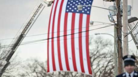 Volunteer firefighters arrive at the church during the