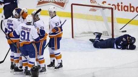 New York Islanders' Johnny Boychuk, Ryan Strome, John