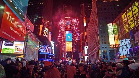 Fireworks explode overhead as revelers celebrate New Year's