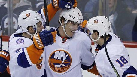 New York Islanders' Frans Nielsen, Anders Lee and