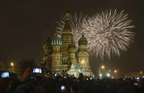 Fireworks explode over St. Basil's Cathedral as people