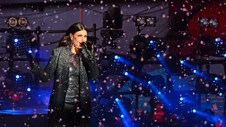 Idina Menzel performs in Times Square as part