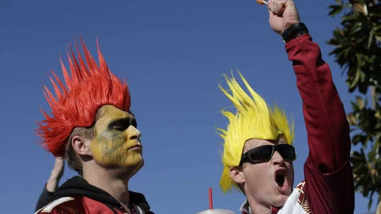 Florida State fans Drew Meyer, left, and Trevor