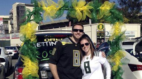 Oregon fans Steve Twomey and Lisa DeFluri pose