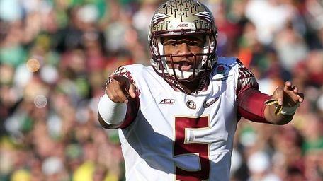 Florida State quarterback Jameis Winston signals to his