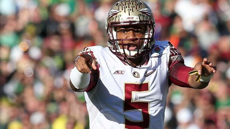 Florida State quarterback Jameis Winston signals to his