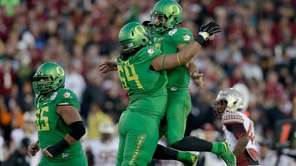 Quarterback Marcus Mariota of the Oregon Ducks celebrates