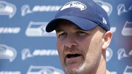 Seattle Seahawks defensive coordinator Dan Quinn talks to
