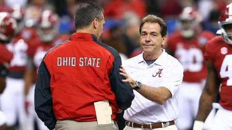 From left, head coach Urban Meyer of the