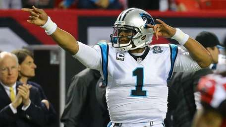 Panthers quarterback Cam Newton makes a first down