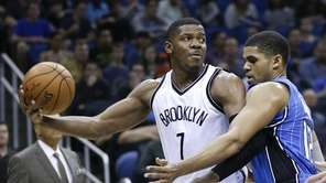 Brooklyn Nets' Joe Johnson looks to pass the