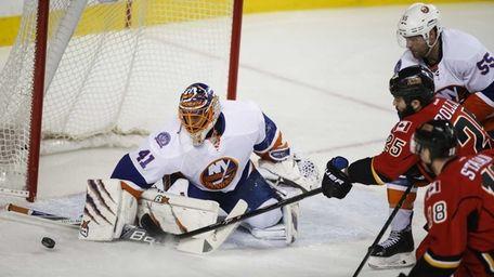 New York Islanders goalie Jaroslav Halak, left, blocks