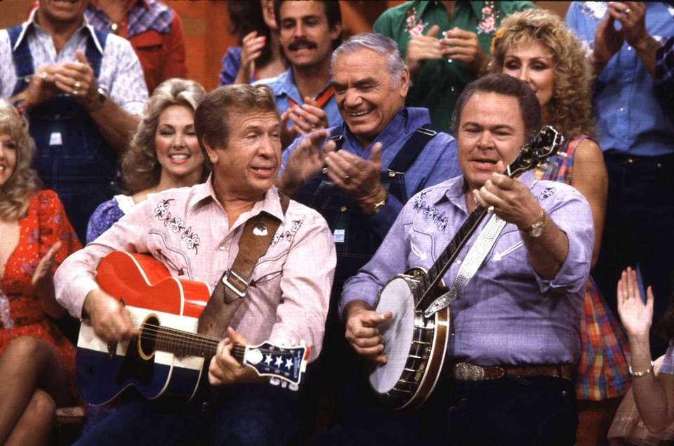 Buck Owens, left, with