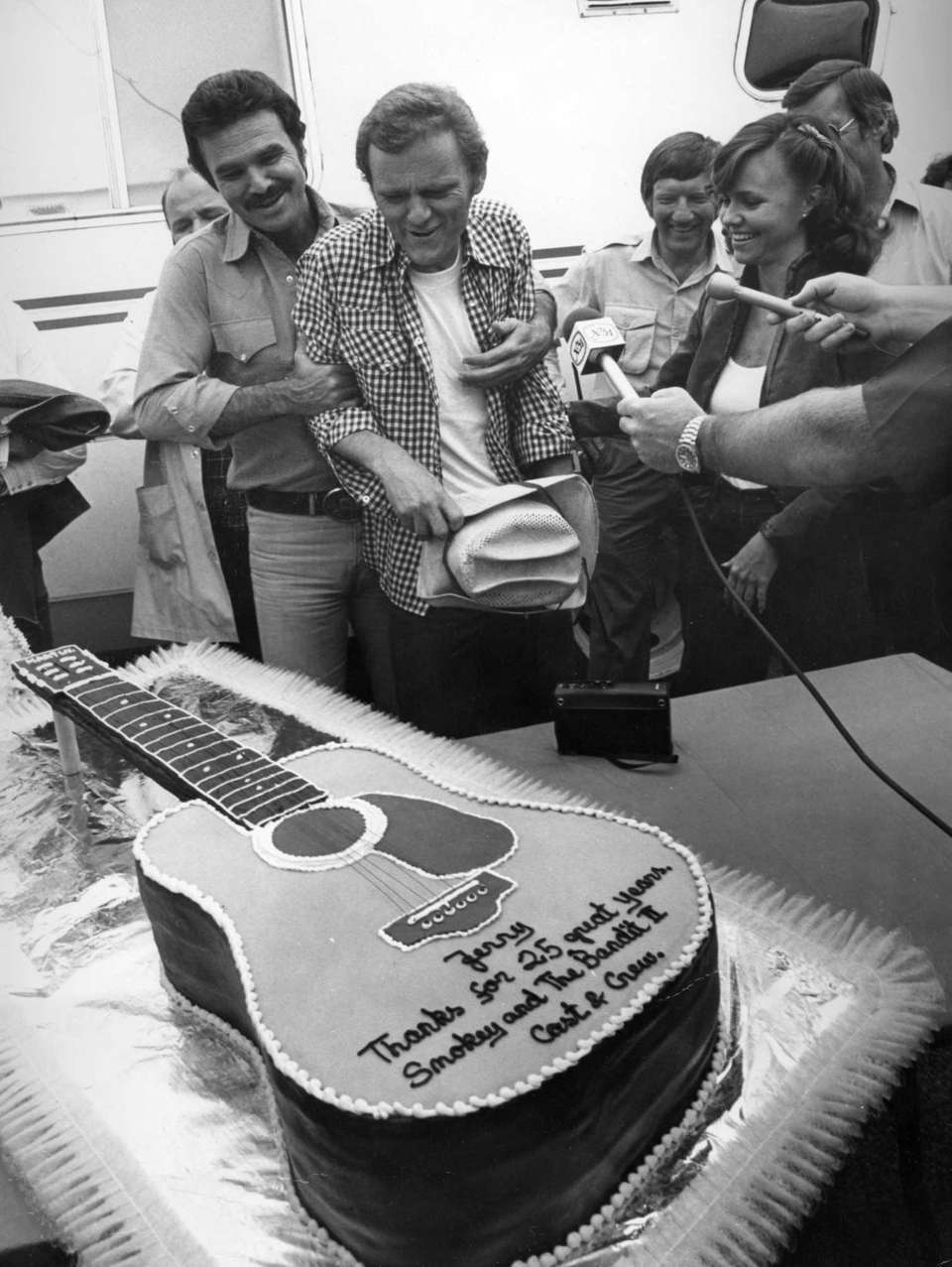 In this March 1980 photo, Jerry Reed, center,