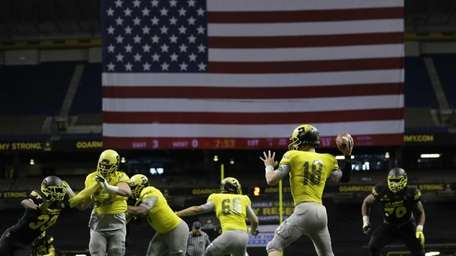 U.S. Army All-American West's Ricky Town (18) passes