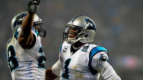 Cam Newton and Jonathan Stewart of the Carolina