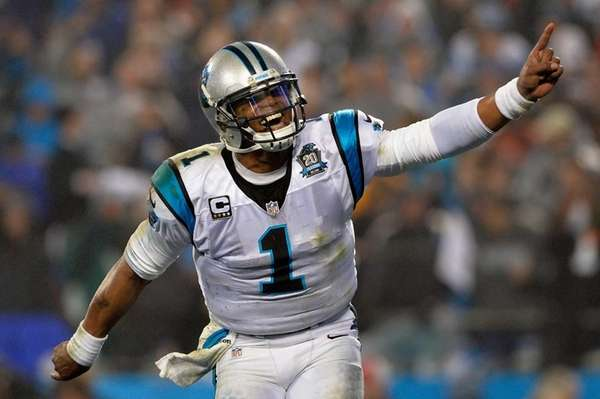 Cam Newton of the Carolina Panthers celebrates during