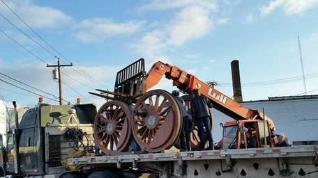 Volunteers from the Oyster Bay Railroad Museum load
