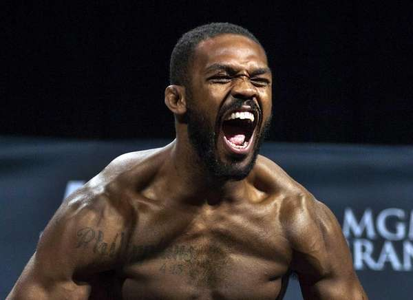 Jon Jones screams for the fans during weigh-ins