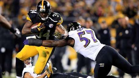 Ben Tate of the Pittsburgh Steelers is tackled