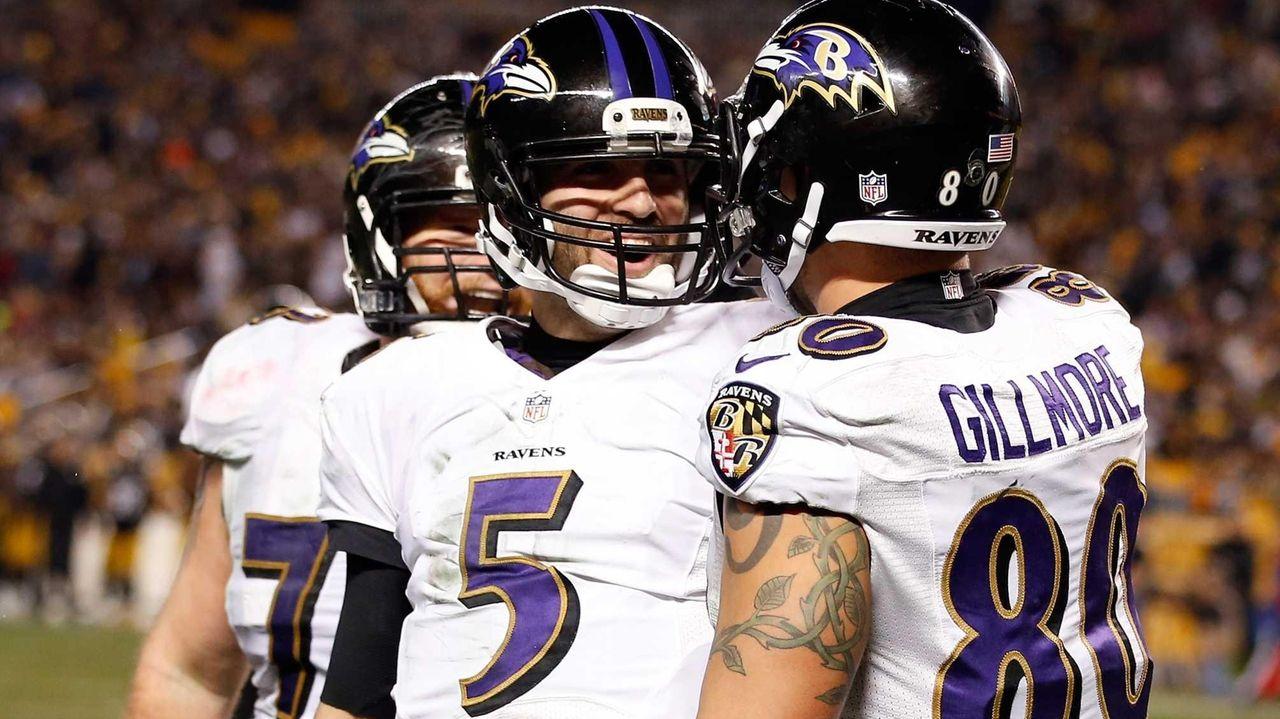 Crockett Gillmore celebrates a fourth-quarter touchdown with Joe