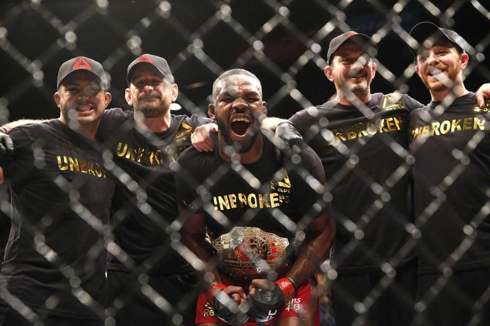 Jon Jones celebrates while posing with his corner